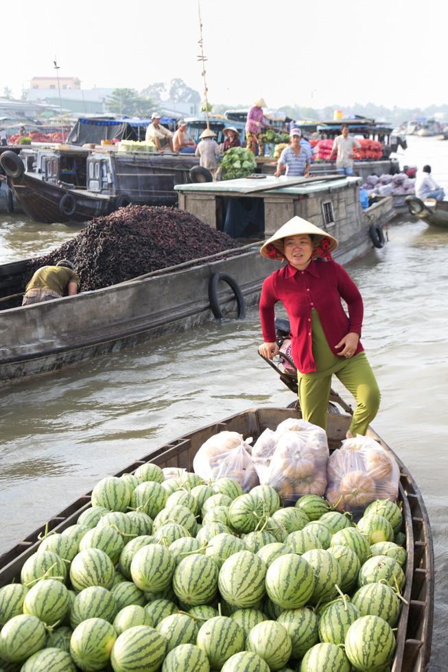 Boot mit Melonen, Schwimmender Markt im Mekong Delta, Vietnam